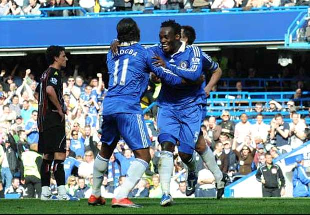 Michael Essien in a hearty embrace with Drogba