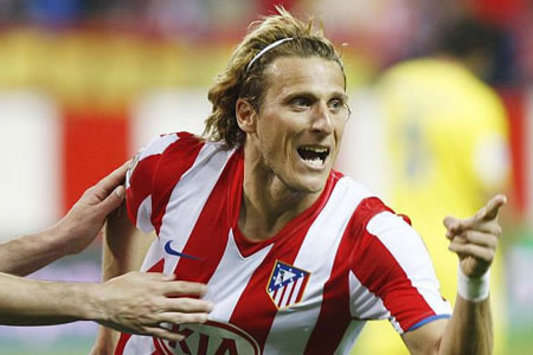 Atletico Madrid striker Diego Forlan celebrates scoring against his old side Villarreal