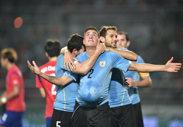 South Korea 0 Uruguay 1: Stielike watches on as Gimenez strikes