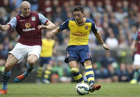 Ozil stars as Arsenal breeze past Villa
