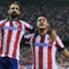 Juanfran y Koke celebran un gol