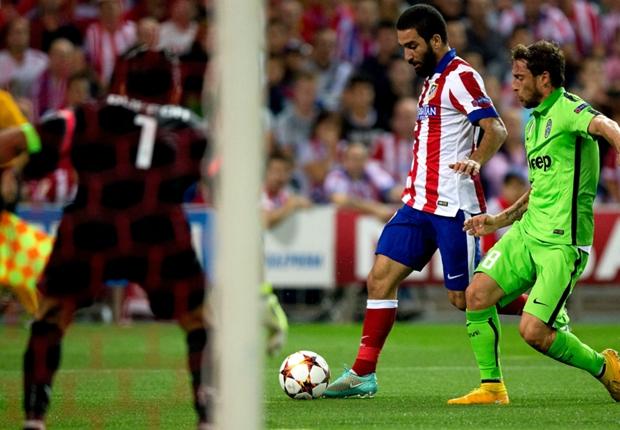 Arda Turan in azione durante Atletico Madrid-Juventus.