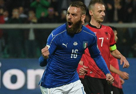 Italy win to keep pace with Spain