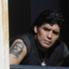 Diego Armando Maradona, con rostro serio