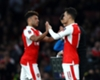 Manchester United monitoring Arsenal duo Alex Oxlade-Chamberlain and Mesut Ozil