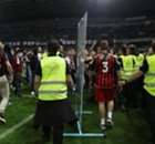 Fifteen arrested after pitch invasion