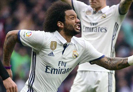 Marcelo saves huge win for Madrid