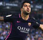 Suarez keeps Barcelona in title race