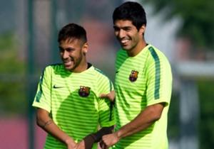 The Uruguay star shares a joke with attacking partner Neymar