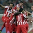 Olympiacos celebrate a goal against Atletico Madrid