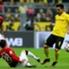 Hannovers Kiyotake grätscht vor Dortmunds Gündogan
