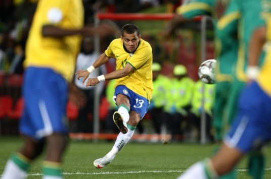 2009 FIFA Confederations Cup: Daniel Alves of Brazil takes the freekick from which he scores the winner against South Africa (PA)