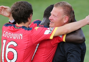 Awer Mabil heads straight for coach Josep Gombau after putting Adelaide United 2-0 up at home to Perth Glory
