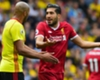 Liverpool's Emre Can (R) argues with Younes Kaboul of Watford
