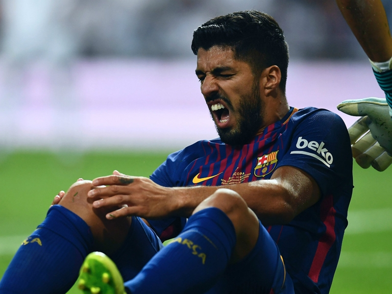 Injured Suarez ruled out for up to five weeks as Barca woes mount