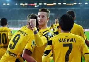 Borussia Dortmund team-mates celebrate Marco Reus' goal