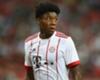 Bayern Munich's David Alaba watches on.