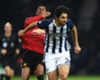 West Brom defender Ahmed Hegazi tussles with Marcus Rashford