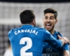 Marco Asensio celebrates with Real Madrid team-mate Dani Carvajal