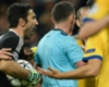 Gianluigi Buffon argues with Michael Oliver