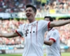 Bayern Munich's Robert Lewandowski celebrates a Bundesliga record