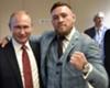Conor McGregor (R) with Russia president Vladimir Putin
