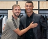 Juventus midfielder Miralem Pjanic (L) and new team-mate Cristiano Ronaldo (R)