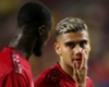 Manchester United's Andreas Pereira speaks with Eric Bailly