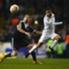 Tottenham and Partizan players battle