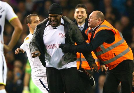 Uefa charge Spurs for pitch invasions