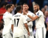 Real Madrid celebrate Karim Benzema's early goal