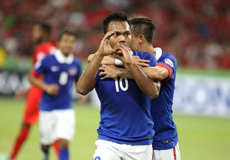 Late drama breaks Singapore hearts and sends Malaysia through