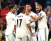 Real Madrid celebrate a goal by Karim Benzema