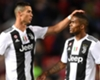 Cristiano Ronaldo (L) and Juventus team-mate Douglas Costa (R)