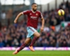 Reid won't be affected by Arsenal talk