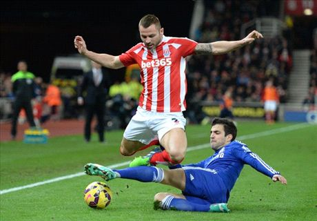 Fabregas finishes off stubborn Stoke