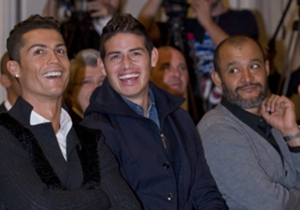 Valencia coach Nuno looks on as Ronaldo and James find something funny