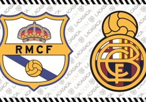 Así verían al revés, los escudos del Real Madrid y Barcelona.