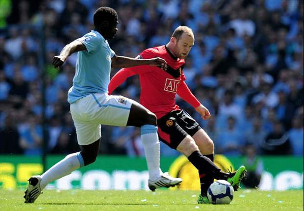 Manchester City 0-1 Manchester United: Paul Scholes keeps Red Devils title hopes alive with last gasp derby winner